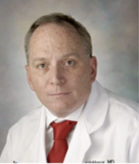 Headshot of Dr. McManus in white coat and red tie